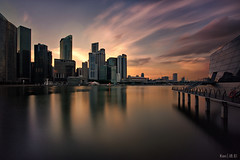 Invisible Sun Sunset (Ken Goh thanks for 1,900,000+ views) Tags: lighting sunset red sky cloud reflection building water silhouette night buildings louis singapore long exposure pentax designer smooth sigma 1020 architeture vuitton k3 citiscape