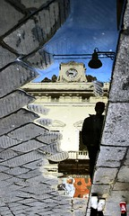 Bad boys (meghimeg) Tags: reflection clock boys lamp puddle explore orologio lampione riflesso ragazzi pozzanghera savona selciato 2013