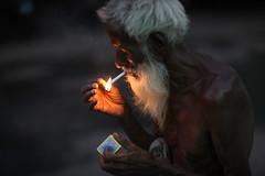 LIGHT is all you need (N A Y E E M) Tags: street light portrait evening raw cigarette candid beggar bangladesh gec unedited chittagong sooc harunarrasheed