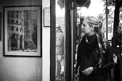 a clean well-lighted place (omoo) Tags: newyorkcity bw window glass girl reflections store closed village hand display westvillage sidewalk blonde framing streetscenes greenwichvillage pictureframes bleeckerstreet frameshop acleanwelllightedplace bwphotograph sinceclosed artphptography