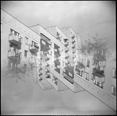 1312250305 (Marcin Kubiak) Tags: city urban bw concrete mirror blackwhite holga cityscape doubleexposure surrealism dream surreal poland warsaw epson blocks analogue delta3200 mx ilford homeland 120mm 3200iso v500 ursynow