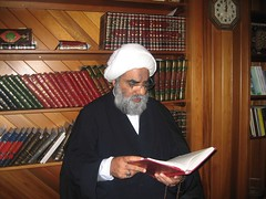Sheikh reading at his Office