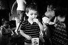 the popcorn monster (Fine Detail Films) Tags: boy portrait bw canon raw availablelight candid 28mm fineart highcontrast sigma birthdayparty popcorn 7d manual f18 nocrop lightroom inthezone manualprocess