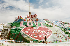 Salvation Mountain (Andre Guerette) Tags: art visionaryenvironment sculpture leonardknight paint religious godislove sky california portra kodakportra np400 color colour film analog salvationmountain slabcity desert installation 35mm canonf1 slr fdf18 polarizer