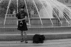 Playing bagpipe (Giulia Gasparoni) Tags: play playing bagpipe pipe street art artist streetartist streetart fountain man human people person beautiful awesome amazing city life genova geova italy beard music nice tell story stories dreamy dreamers photography vintage retro indie old monochrome black white blackwhite blackandwhite