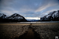 Crack in the Road (ryan.kole32) Tags: banff banffalberta banffnationalpark nationalpark landscape nature beauty beautyinnature perspective depthoffield sunrise lakeminnewanka road street crack clouds cloudy lake winter ice snow frozen sony sonya77 teamsony pavement travel outdoors