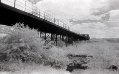 Railway Bridge at Ledstone Ings (Saturated Imagery) Tags: bridge blackandwhite film 35mm ir iso400 railway infrared riveraire kodakhie castleford fairburnings aireandcaldernavigation prakticatl5b