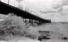 Railway Bridge at Ledstone Ings (Saturated Imagery) Tags: bridge blackandwhite film 35mm ir iso400 railway infrared riveraire kodakhie castleford fairburnings aireandcaldernavigation prakticatl5b