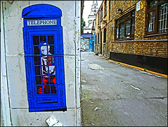 Punk in a blue telephone box (tim constable) Tags: street city blue windows urban london art church sign skyline buildings private poster graffiti tv stencil bars mural punk closed comic quiet view surveillance noparking watch property cage cctv security scene backstreet attitude brickwall cameras alleyway ob
