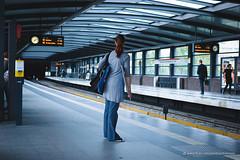 waiting for a(n) U2 to Ruhleben (double gauss) Tags: blue people woman white berlin standing grey daylight waiting ubahnhof platform ubahn mb ubhf pnv backshot august2013 3x2horizontal