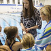 "<b>Aquatic Center Dedication of Service_100413_0311</b><br/> Photo by Zachary S. Stottler Luther College '15  Two time Olympic Silver Medalist Christine Magnuson tells the Miller children how she won her medal in the Beijing Olympics in 2008.<a href=""http://farm4.static.flickr.com/3765/10095611975_2d1cb4821b_o.jpg"" title=""High res"">∝</a>"