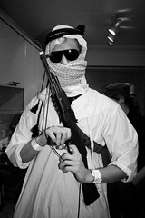 The War Against Terror party (Gary Kinsman) Tags: party portrait bw man london sunglasses houseparty scarf blackwhite gun flash shades late twat fancydress canonrebelxt 2007 canadawater trashed toygun surreyquays keffiyeh se16 canon1855mm thewaragainstterror jihadi no75