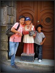 Jamais 2 sans 3..... (LILI 296....!!!) Tags: boy statue religion humor humour porte enfant laval garon malte canonpowershotg12 croisiremagiquemditerrane
