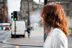 Toxic Breath (Leanne Boulton) Tags: life road street city light red portrait people urban woman cloud color colour bus toxic girl field car modern female contrast canon hair lights scotland living ginger aperture focus colorful long pretty crossing traffic bokeh pavement glasgow cigarette candid smoke breath profile young style pedestrian scene smoking redhead sidewalk human shade colourful van smoker footpath wavy depth tobacco exhale exhaling