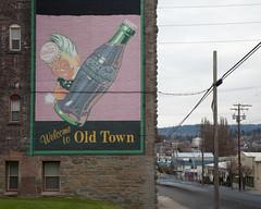 Old Town (K-Rock Design) Tags: longexposure color colour building brick sign stone architecture painted wires bellingham cocacola oldtown welcomesign 2014 krockdesign jitaekpark