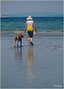 A woman and her dog (marneejill) Tags: woman dog love beach reflections walking sand waves candid connection parksville owner qualicum companions