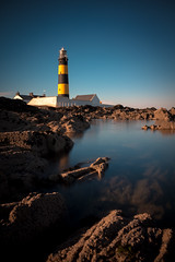 St Johns Point Lighthouse (RyanSimpsonNI) Tags: ocean blue ireland sunset sea summer lighthouse black tower water yellow newcastle high rocks peace stripes tide sunny northernireland tall graduated countydown dundrum ballykinler