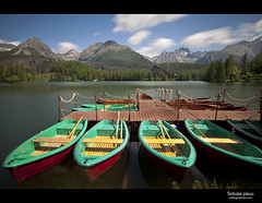 trbsk Pleso (esslingerphoto.com (Off to the Dolomites)) Tags: world 2003 longexposure vacation mountain lake holiday ski mountains reflection building tree cup wet water clouds canon boats photography eos hotel boat photo jump jumping dock freestyle europe exposure skiing shot hill rental competition row landing single junior rowboat slovakia championships tatras tatra fis mkii pleso esslinger trbsk esslingerphotocom esslingerphoto
