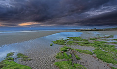 Nairn Beach. (Gordie Broon.) Tags: ocean sea seascape green beach june clouds reflections geotagged evening scotland sand scenery rocks alba scenic escocia northsea nairn schottland morayfirth ecosse 1740l darkskies scott