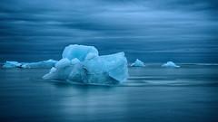 Eisberg im Meer (swissgoldeneagle) Tags: longexposure sea cloud clouds dark island iceland meer wolke wolken iceberg dunkel eisberg langzeitaufnahme d700
