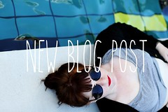 Blog Post [14/08/2013] (kaitlynslocombe) Tags: portrait pool girl sunglasses fringe lying redhair bun midriff