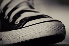 Shoes (somnium_ars) Tags: autumn shadow blackandwhite bw macro fall shoes converse chucks laces