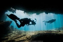 Underwater Cave (tonyrathphotography) Tags: ocean travel blue sea wild nature water beauty silhouette sport coral photography divers marine underwater natural outdoor belize dive scuba diving submarine tropical cave diver recreation reef cavern sanpedro videographer southwatercaye mexicorocks blz belizedistrict