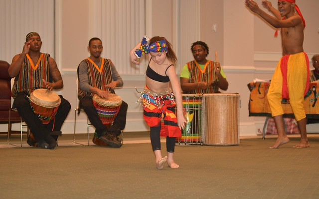 A member of the Sankofa dance troop entertains the audience at the University's Dover site in celebration of Black History Month.