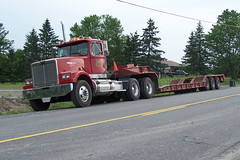 Western Star day cab truck with a tridem tri-axle float trailer Ottawa, Ontario Canada 06262008 ©Ian A. McCord (ocrr4204) Tags: red ontario canada truck rouge kodak ottawa camion pointandshoot parked trailer mccord trucking gooseneck tractortrailer westernstar lowboy tridem z740 remorque northgower dropdeck fishbelly daycab triaxle heavyhauler lowbed ianmccord ianamccord