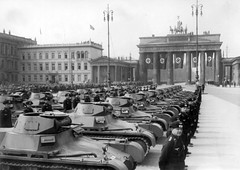 Military parade of German troops in Berlin near the Brandenburg Gate. Tanks Pz.Kpfw. I Ausf. B and their crews can be seen.