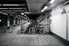Grand Central (kenzodiazepine) Tags: new york film monochrome station bike bicycle central grand xp2 ilford