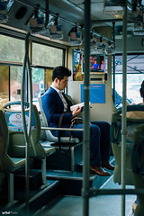 The reader in suits #Leica #Street (unTed) Tags: china street leica city people color 35mm beijing streetphotography documentary summicron f2 asph leicam leicam240