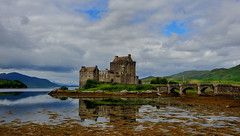 Eilean Donan (images@twiston) Tags: eileandonancastle eileandonan iconic eilean donan castle dornie scotland loch lochduich lochalsh romantic picturesque kyle kyleoflochalsh western west highland cloud clouds bridge historic tide sea seawater arches scottishhighlands scottishwesternhighlands isleofskye icon seaweed reflections clanmacrae clanmackenzie highlander film movie mountain mountains saltire chateau reflection architecture skye island hill hills summer day dark sky water lochside landscape glen islands a87 sgurrmhicbharraich kintailnationalscenicarea cuillin cuillins ridge imagestwiston shore bladderwrack alba highlands lochlong glenshiel thesaddle kintail schottland caledonia ecosse escoia
