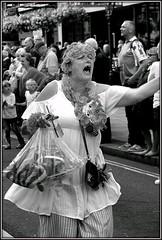 Lady lodger (* RICHARD M (Over 6 million views)) Tags: street candid portraits portraiture streetportraits streetportraiture candidpoprtraits candidportraiture mono blackwhite orangeorder orangelodge loyalorangelodge lol loyalorangeinstitution 12thjuly drunk inebriated inebbreatedwoman dunkenwoman sozzled hitmissed tankedup gummy gumsofgold missingteeth garlands southport sefton merseyside parades characters loud noisey action thedecisivemoment flowersinherhair omg uhoh agrh troublebrewing
