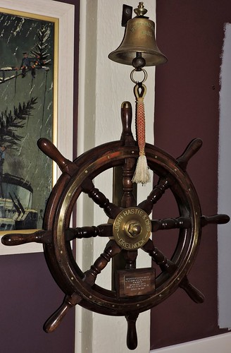 Ship's steering wheel and bell
