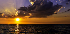 Rorschach Sunset (C. P. Ewing) Tags: sunset sun clouds cloud ocean gulf sea seascape landscape sky nature outdoors orange blue yellow colorful beautiful natural