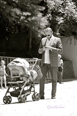 Go... dad on the go! (g.zeidman) Tags: man guy dad stroller father suit busy fatherhood multitasking texting