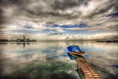 Peace and war (Nejdet Duzen) Tags: trip cloud reflection turkey boat day cloudy jetty trkiye iskele sandal warship izmir bulut yansma turkei seyahat inciralt savagemisi buluttravel