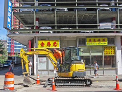 BostonParkEatDig (fotosqrrl) Tags: urban boston construction parkinglot massachusetts streetphotography worker bostonma cf roadwork chineserestaurant excavator leatherdistrict beachstreet safetycones bostonchinatown bestbarbqrestaurant leungsrestaurant