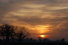 Occluded sunset (Kirkleyjohn) Tags: sunset sky sun silhouette clouds atardecer evening countryside sonnenuntergang pôrdosol coucherdusoleil