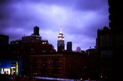 Empire State Building (from the Highline) (metro special) Tags: city nyc newyorkcity urban newyork film night silver cloudy manhattan grain olympus scanned empirestatebuilding velvia100 highline brickbuilding om1n olympusom1n