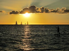 sunset on Oahu (kenjet) Tags: ocean sunset sun beach water weather clouds hawaii evening day pacificocean rays sailboats pwpartlycloudy