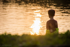 Boy by the lake (Taipei street life) Tags: light boy sunset lake reflection water pool ripple atmosphere aura