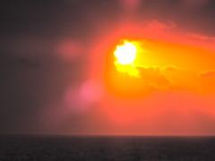 Orange to Purple (Omi<3) Tags: ocean light sunset orange sun yellow clouds dark purple rays cruises