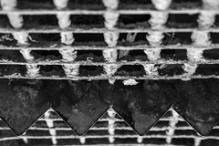 ww (primemundo) Tags: symmetry triangles squares triangle square pointy rust blackandwhite monochrome odc symmetrical