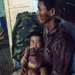 Hue 1972 - Distraught Vietnamese father holds his wounded child thumbnail
