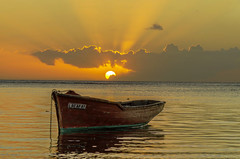 Fishing Boat...Sunset (Malaquin Eric ........ thanks for your visits & co) Tags: mauritius maurice ericmalaquin fishingboat water sea seaside seascape sunset clouds coucherdesoleil colors cumulonimbus canoe boat barque atmosphere albion reflection lagoon lagon light sky sun sundown pentax panoramicphoto endoftheday
