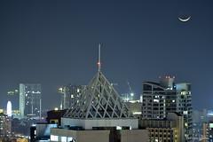 Waxing crescent moon over Manila (Sumarie Slabber) Tags: moon nightphotography citylights manila philippines sumarieslabber photographer buildings waxingcrescent night