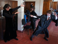 Wizard duel (Pima County Public Library) Tags: motion point fight bestof cosplay wizard wand harrypotter battle snape hotelcongress bookmans harryandthepotters potterparty bellatrix wizardrock pimacountypubliclibrary hatptucson pcplphotolibrary