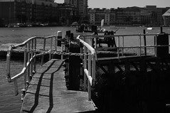 Barge (Joey Scannell) Tags: city bridge shadow bw white lake black blur water metal river joseph graffiti canal mine close zoom ripple steel chain barge thick scannell